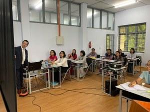 <Photo 3: Associate Professor Uchida conducting<br />a class>