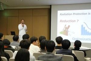Chief Ichida talks in front of the Korean students