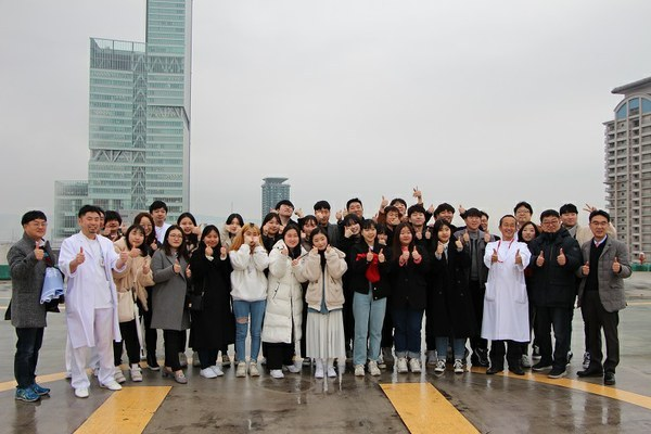 Group photo at the heliport