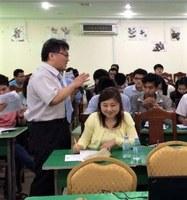 Lecturer Naganuma<br />conducting a class at<br />International University,<br />Cambodia