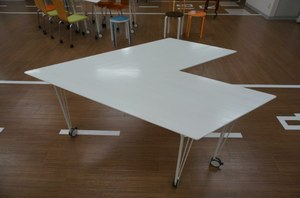 Global Village paper airplane table